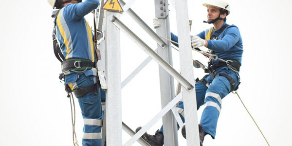 men working on a transmission tower